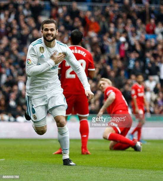 Nacho Fernandez of Real Madrid celebrates after scoring during the La Liga match between Real Madrid and Sevilla at Estadio Santiago Bernabeu on...