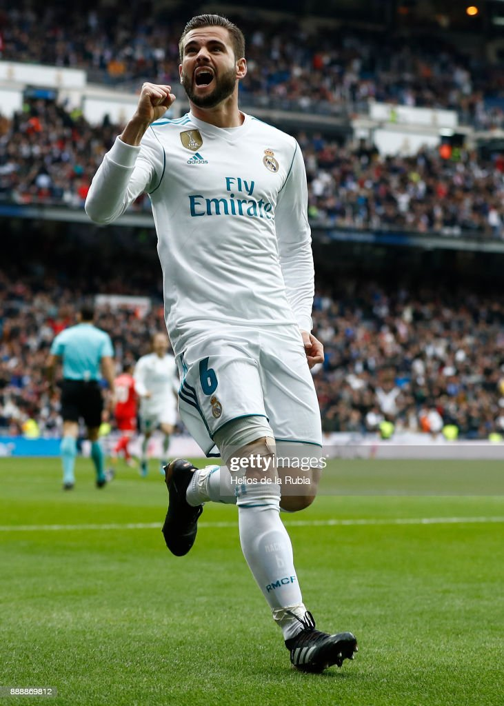 Nacho Fernandez of Real Madrid celebrates after scoring during the La Liga match between Real Madrid and Sevilla at Estadio Santiago Bernabeu on December 9, 2017 in Madrid, Spain.