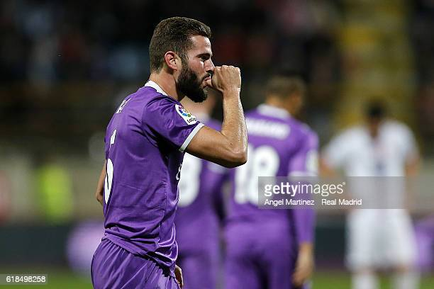 Nacho Fernandez of Real Madrid celebrates after scoring his team's sixth goal during the Copa del Rey round of 32 first leg match between Cultural y...