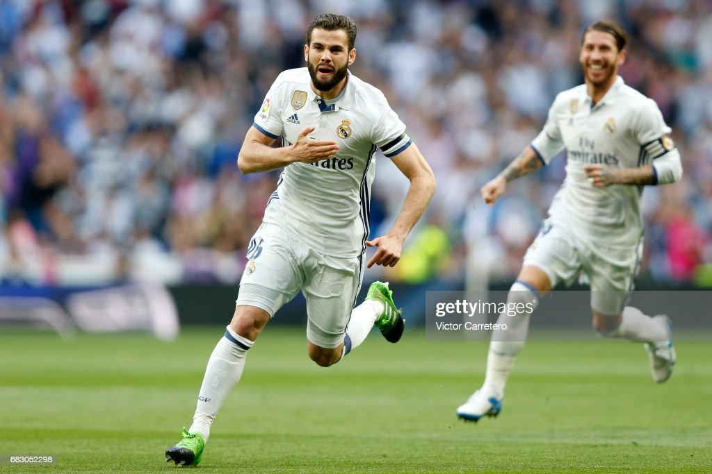 Nacho Fernandez of Real Madrid celebrates after scoring the opening goal during the La Liga match between Real Madrid and Sevilla FC at Estadio Santiago Bernabeu on May 14, 2017 in Madrid, Spain.