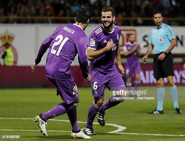 Nacho Fernandez of Real Madrid celebrates with Alvaro Morata after scoring their team's sixth goal during the Copa del Rey round of 32 first leg...