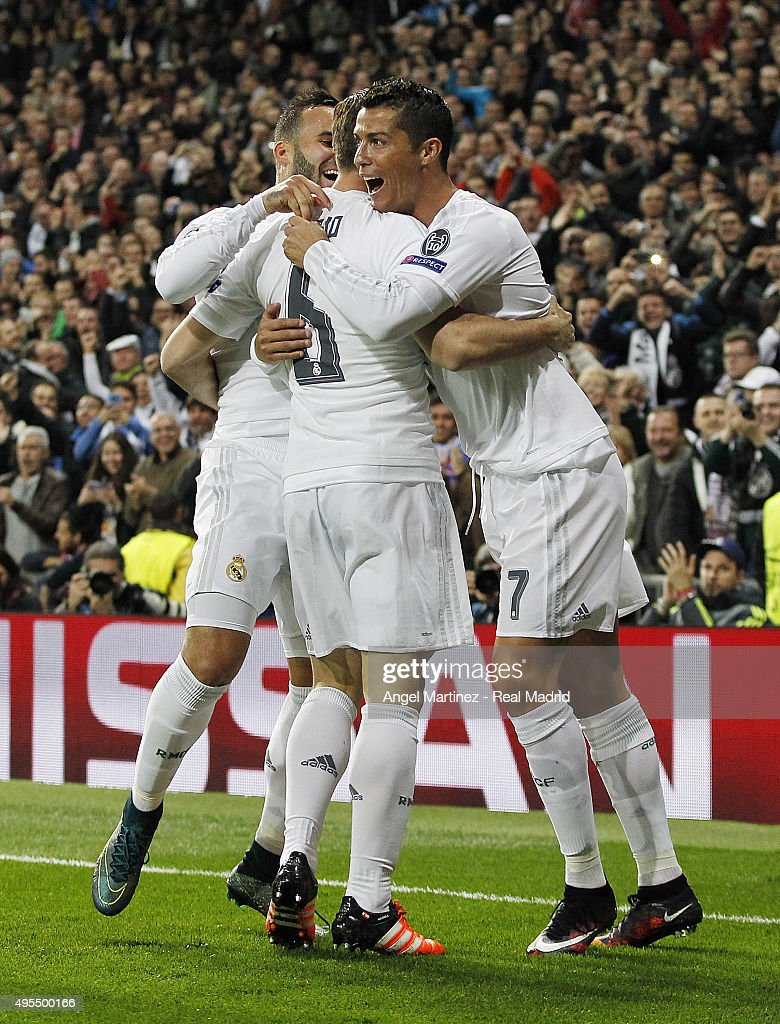 Nacho Fernandez (C) of Real Madrid celebrates with Cristiano Ronaldo (R) and Jese Rodriguez after scoring the opening goal during the UEFA Champions League Group A match between Real Madrid and Paris Saint-Germain at Estadio Santiago Bernabeu on November 3, 2015 in Madrid, Spain.