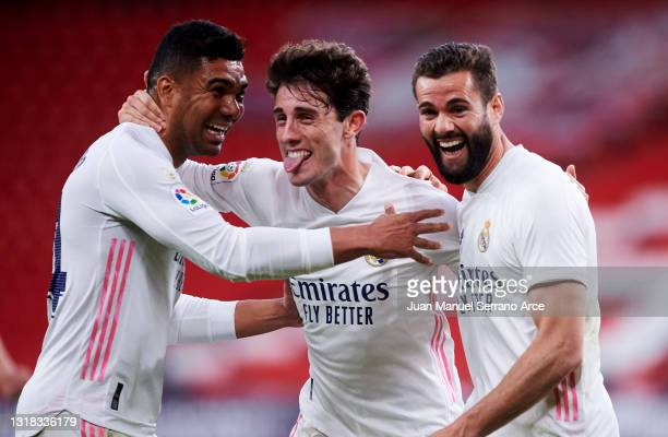 Nacho Fernandez of Real Madrid celebrates with his teammate Carlos Casemiro and Alvaro Odriozola of Real Madrid after scoring the opening goal during...