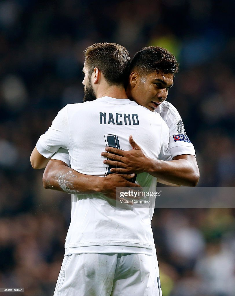 Nacho Fernandez of Real Madrid celebrates with his teammate Casemiro at the end of the UEFA Champions League Group A match between Real Madrid and Paris Saint-Germain at Estadio Santiago Bernabeu on November 3, 2015 in Madrid, Spain.