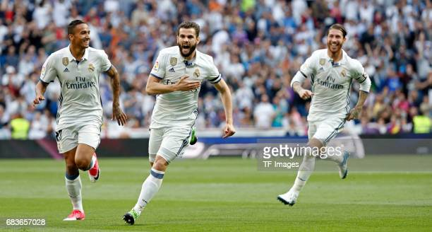 Nacho Fernandez of Real Madrid celebrates with his teammates after scoring the opening goal during the La Liga match between Real Madrid CF and...