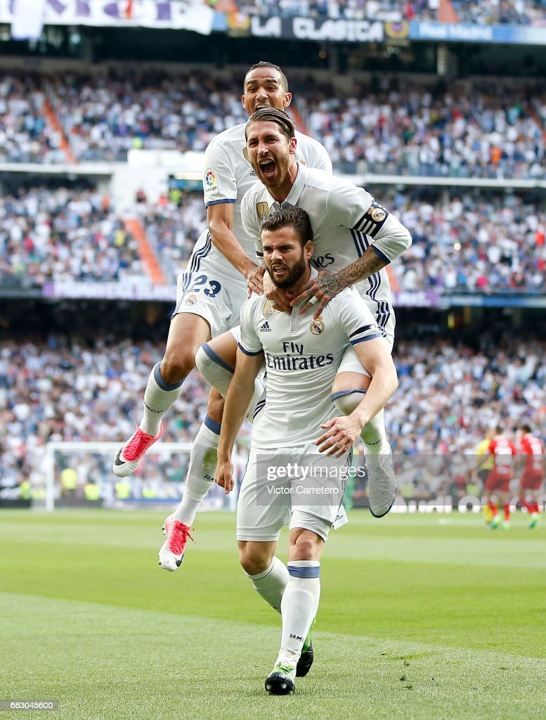 Nacho Fernandez of Real Madrid celebrates with his teammates Sergio Ramos and Danilo after scoring the opening goal during the La Liga match between Real Madrid and Sevilla FC at Estadio Santiago Bernabeu on May 14, 2017 in Madrid, Spain.