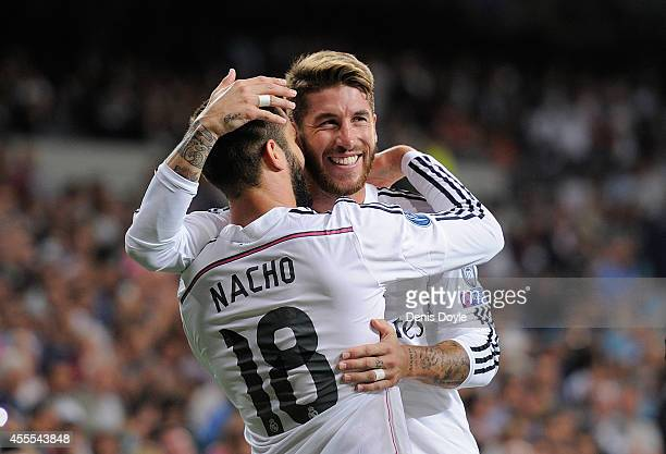 Nacho Fernandez of Real Madrid celebrates with Sergio Ramos after scoring Real's opening goal during the UEFA Champions League Group B match between...