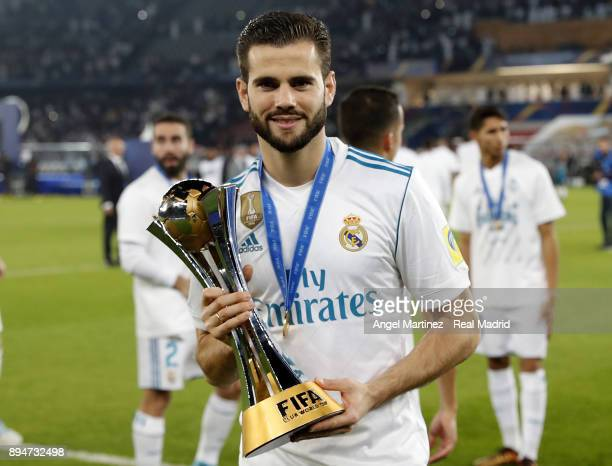 Nacho Fernandez of Real Madrid celebrates with the trophy after the FIFA Club World Cup UAE 2017 Final match between Real Madrid CF and Gremio FBPA...