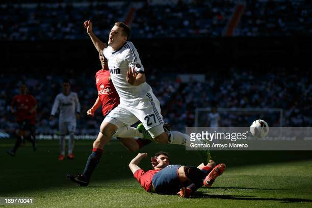 Nacho Fernandez of Real Madrid CF is challenged by Unai Garcia of CA Osasuna during the La Liga match between Real Madrid CF and CA Osasuna at...