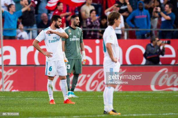 Nacho Fernandez of Real Madrid CF reacts after Cristian 'Portu' of Girona FC scored his team's second goal during the La Liga match between Girona...