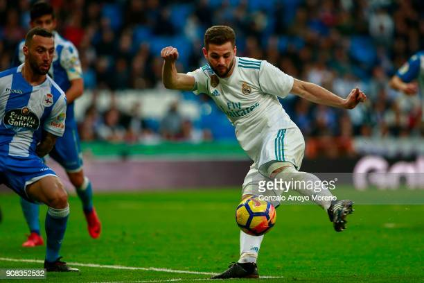 Nacho Fernandez of Real Madrid CF scores their seventh goal during the La Liga match between Real Madrid CF and Deportivo La Coruna at Estadio...
