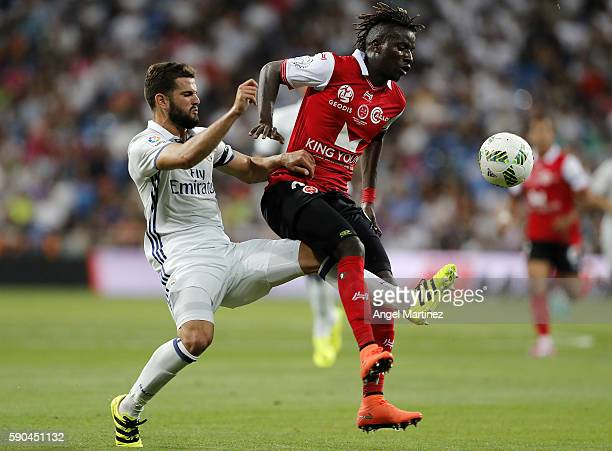 Nacho Fernandez of Real Madrid competes for the ball with Ibrahima Balde of Stade de Reims during the Trofeo Santiago Bernabeu match between Real...