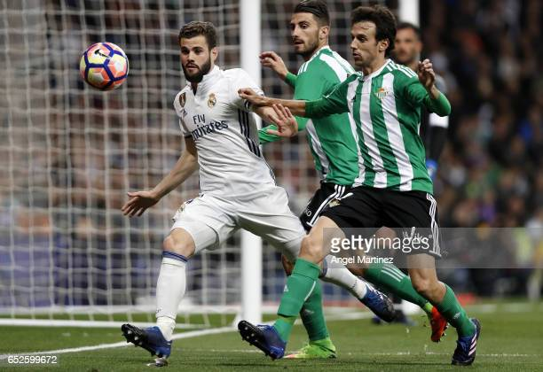 Nacho Fernandez of Real Madrid competes for the ball with Ruben Pardo of Real Betis during the La Liga match between Real Madrid and Real Betis...