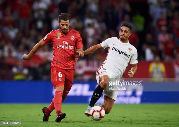 Nacho Fernandez of Real Madrid duels for the ball with Andre Silva of Sevilla FC during the La Liga match between Sevilla FC and Real Madrid CF at...