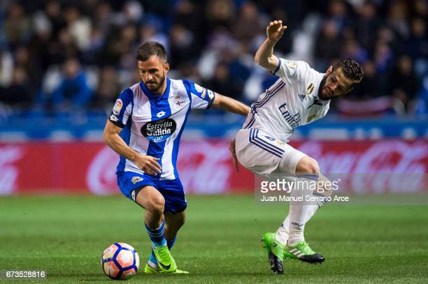 Nacho Fernandez of Real Madrid duels for the ball with Emre Colak of RC Deportivo La Coruna during the La Liga match between RC Deportivo La Coruna...
