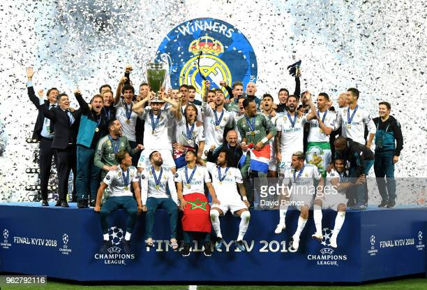Nacho Fernandez of Real Madrid lifts The UEFA Champions League trophy following their side's victory in the UEFA Champions League Final between Real...