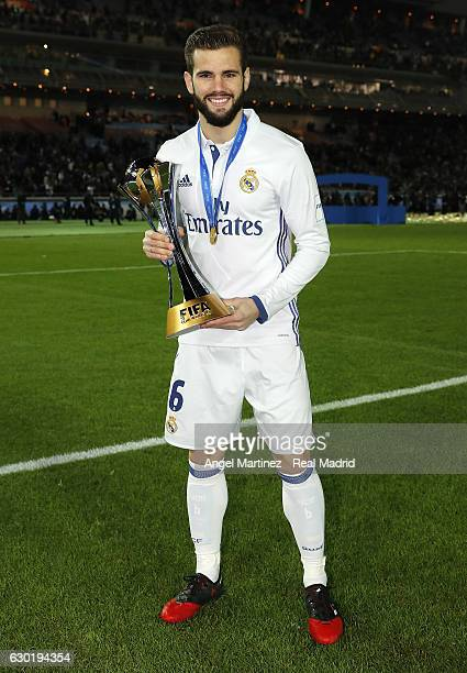 Nacho Fernandez of Real Madrid poses with the trophy after the FIFA Club World Cup Final match between Real Madrid and Kashima Antlers at...