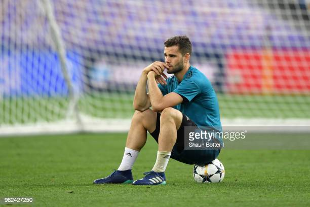 Nacho Fernandez of Real Madrid sits on the ball after a Real Madrid training session ahead of the UEFA Champions League Final against Liverpool at...