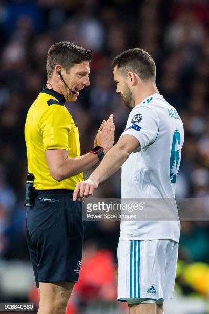 Nacho Fernandez of Real Madrid talks to referee Gianluca Rocchi during the UEFA Champions League 201718 Round of 16 match between Real Madrid vs...