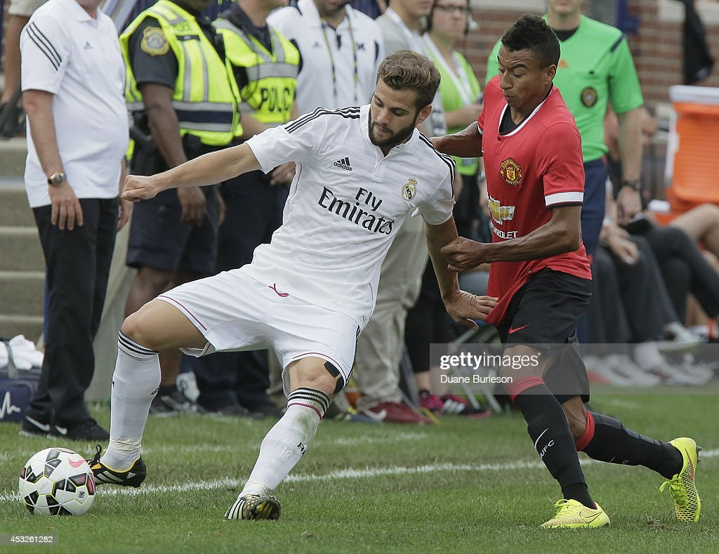 Nacho Fernandez #18 of Real Madrid tries to keep the ball away from Jesse Lingard #35 of Manchester United during the second half of the Guinness International Champions Cup at Michigan Stadium on August 2, 2014, in Ann Arbor, Mich