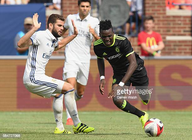 Nacho Fernandez of Real Madrid trips Bertrand Traore of Chelsea during the 2016 International Champions Cup match between Real Madrid and Chelsea at...