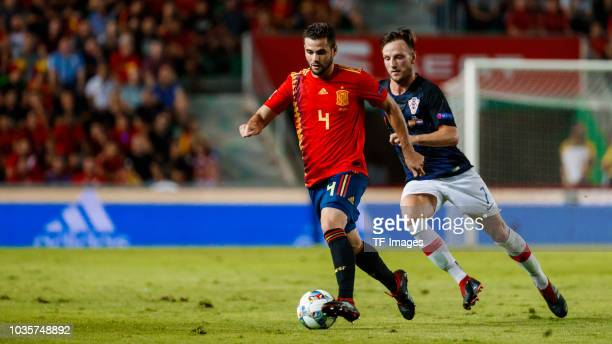 Nacho Fernandez of Spain and Croatia's Ivan Rakitic battle for the ball during the UEFA Nations League A group four match between Spain and Croatia...
