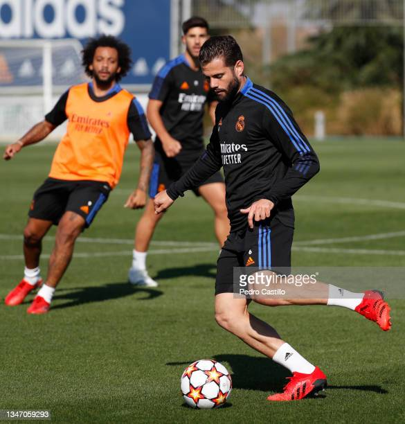 Nacho Fernández and Marcelo Silva both of Real Madrid during training at Valdebebas training ground on October 17, 2021 in Madrid, Spain.