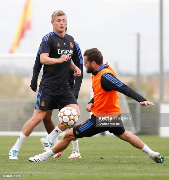 Nacho Fernández and Toni Kroos of Real Madrid are training at Valdebebas training ground on October 16, 2021 in Madrid, Spain.