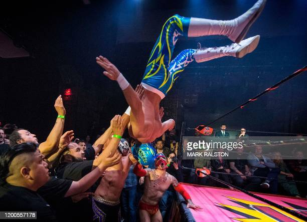 TOPSHOT Nacho Libre wrestlers perform during the Lucha Vavoom 'Valentines Day' show at the Mayan Theatre California on February 12 2020 Lucha Vavoom...