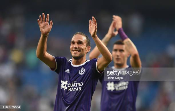Nacho Martínez of Real Valladolid and Sergi Guardiola of Real Valladolid celebrate after drawing during the La Liga match between Real Madrid CF and...