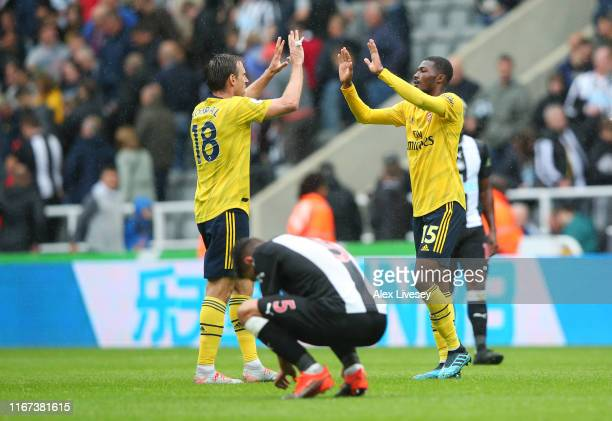 Nacho Monreal and Ainsley MaitlandNiles of Arsenal celebrate victory at fulltime after the Premier League match between Newcastle United and Arsenal...