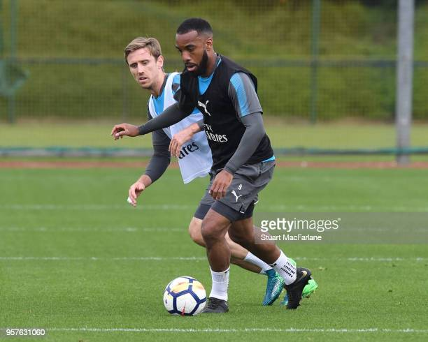 Nacho Monreal and Alex Lacazette of Arsenal during a training session at London Colney on May 12 2018 in St Albans England