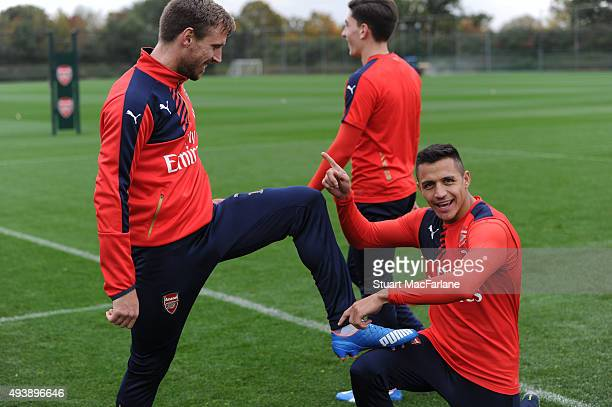 Nacho Monreal and Alexis Sanchez of Arsenal during a training session at London Colney on October 23 2015 in St Albans England