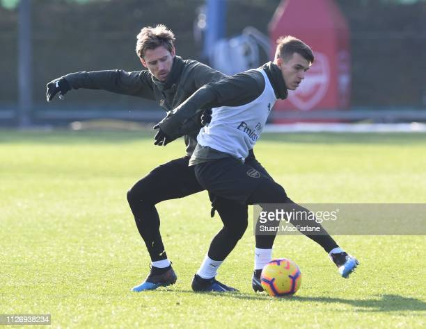 Nacho Monreal and Denis Suarez of Arsenal during a training session at London Colney on February 02, 2019 in St Albans, England.