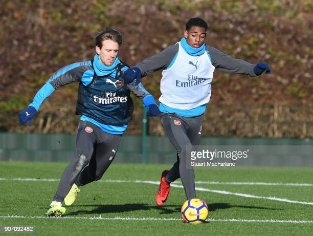 Nacho Monreal and Jeff ReineAdelaide of Arsenal during a training session at London Colney on January 19 2018 in St Albans England