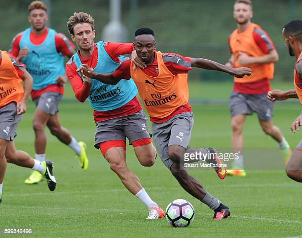 Nacho Monreal and Kelechi Nwakali of Arsenal during a training session at London Colney on September 7 2016 in St Albans England