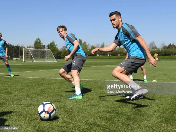 Nacho Monreal and Konstantinos Mavropanos of Arsenal during a training session at London Colney on May 5 2018 in St Albans England