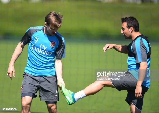 Nacho Monreal and Santi Cazorla of Arsenal during a training session at London Colney on May 5 2018 in St Albans England