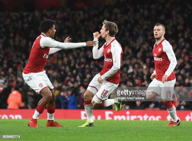 Nacho Monreal celebrate scoring the 1st Arsenal goal with Alex Iwobi during the Carabao Cup SemiFinal Second Leg between Arsenal and Chelsea at...