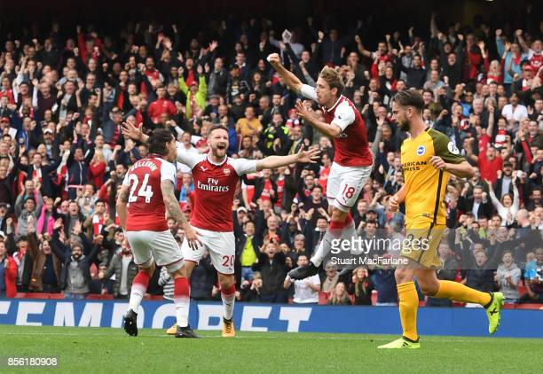 Nacho Monreal celebrates his goal with Hector Bellerin and Shkodran Mustafi during the Premier League match between Arsenal and Brighton and Hove...