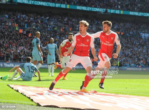 Nacho Monreal celebrates scoring the 1st Arsenal goal with Aaron Ramsey during the Emirates FA Cup Semi-Final match between Arsenal and Manchester...