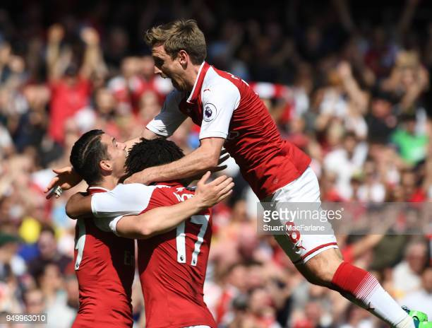Nacho Monreal celebrates scoring the 1st Arsenal goal with Granit Xhaka and Alex Iwobi during the Premier League match between Arsenal and West Ham...