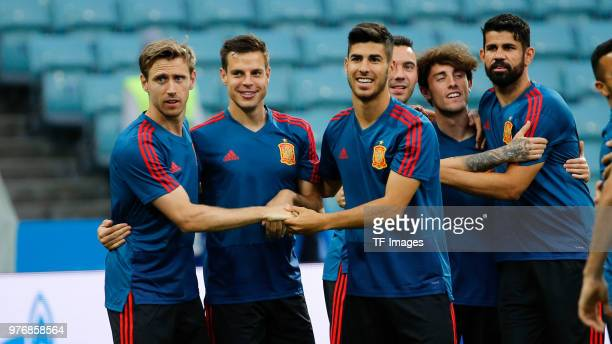 Nacho Monreal Cesar Azpilicueta Marco Asensio Alvaro Odriozola and Diego Costa of Spain laugh during a training session at Fisht Stadium on June 14...