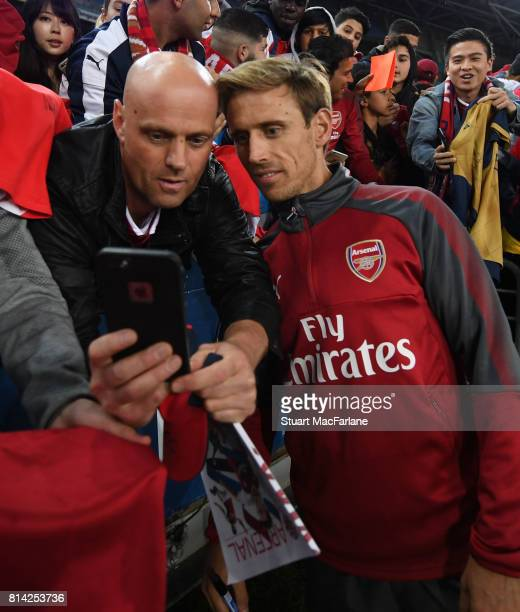 Nacho Monreal has a selfie with an Arsenal fan after a training session at the ANZ Stadium on July 14 2017 in Sydney New South Wales