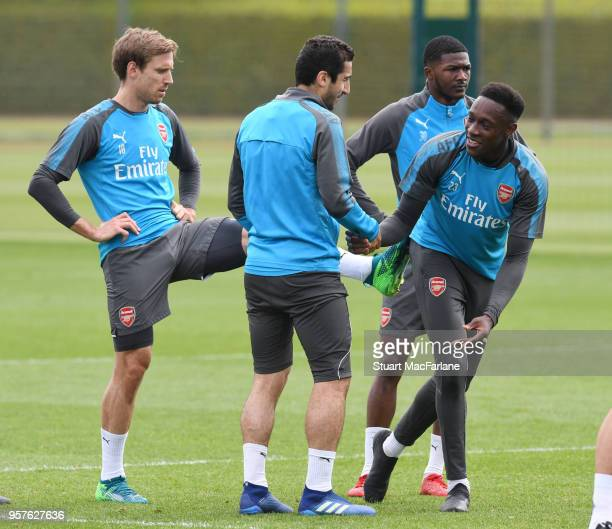 Nacho Monreal Henrikh Mkhitaryan and Danny Welbeck of Arsenal during a training session at London Colney on May 12 2018 in St Albans England