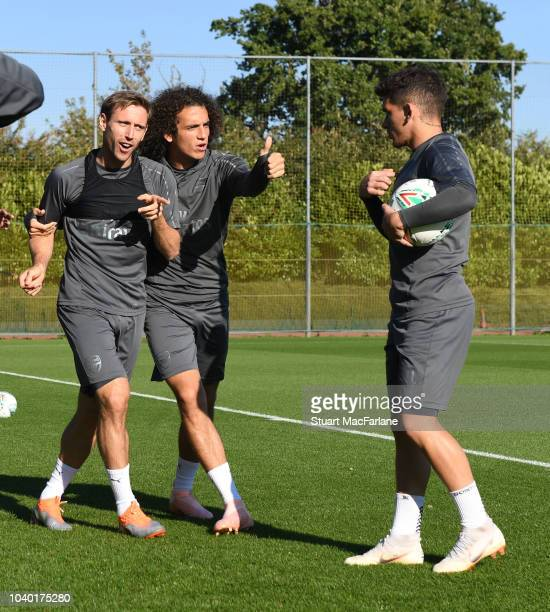 Nacho Monreal Matteo Guendouzi and Lucas Torreira of Arsenal during a training session at London Colney on September 25 2018 in St Albans England