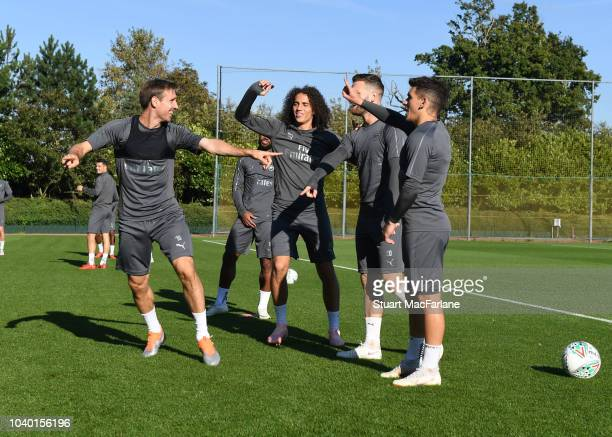 Nacho Monreal Matteo Guendouzi Shkodran Mustafi and Lucas Torreira of Arsenal during a training session at London Colney on September 25 2018 in St...