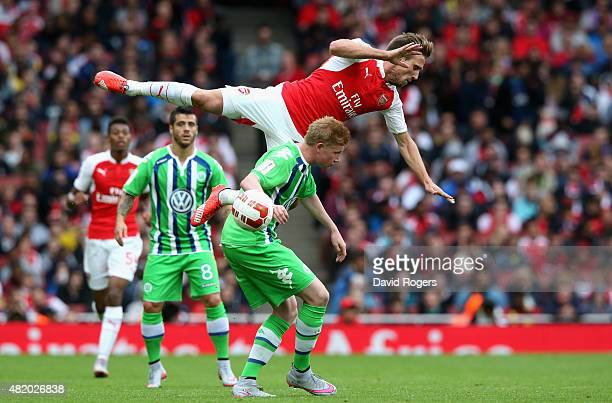 Nacho Monreal of Arsena falls over Kevin de Bruyne during the Emirates Cup match between Arsenal and VfL Wolfsburg at the Emirates Stadium on July...