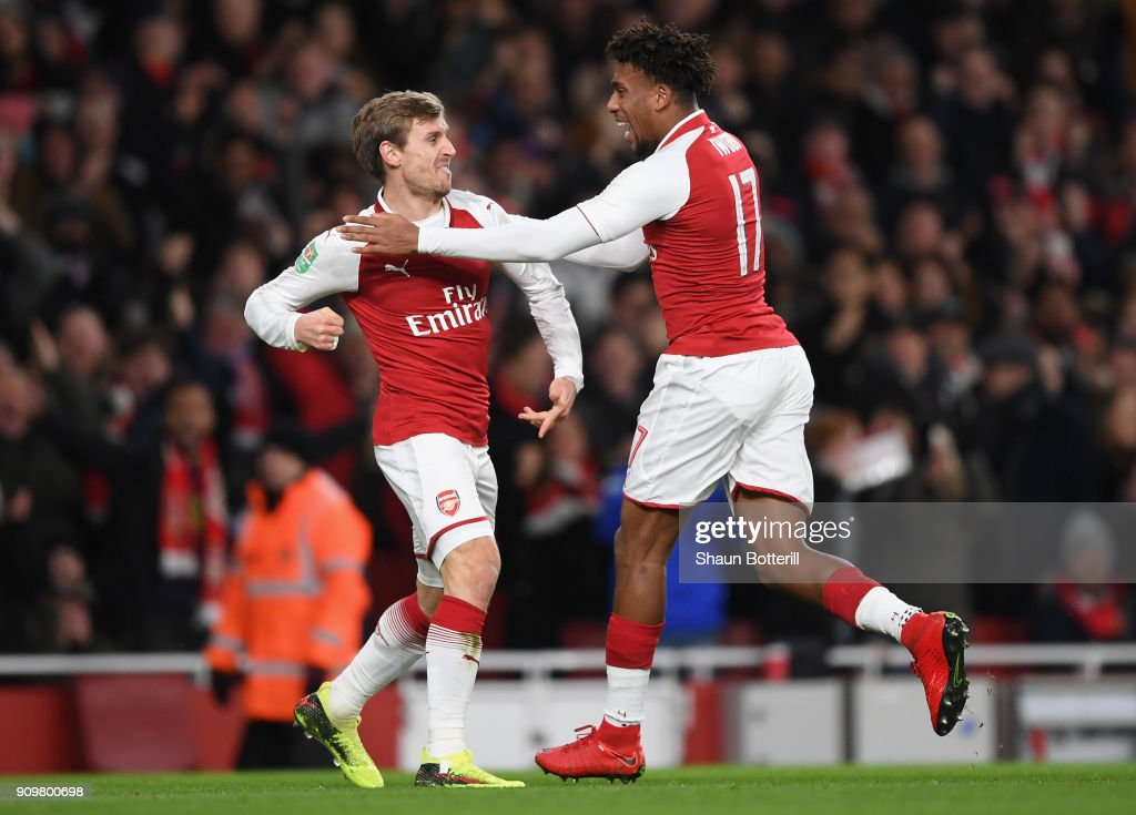 Nacho Monreal of Arsenal and Alex Iwobi celebrate the own goal of Antonio Rudiger of Chelsea during the Carabao Cup Semi-Final Second Leg at Emirates Stadium on January 24, 2018 in London, England.