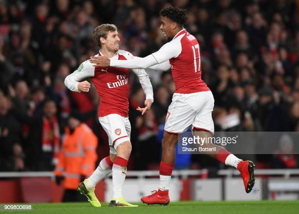 Nacho Monreal of Arsenal and Alex Iwobi celebrate the own goal of Antonio Rudiger of Chelsea during the Carabao Cup SemiFinal Second Leg at Emirates...
